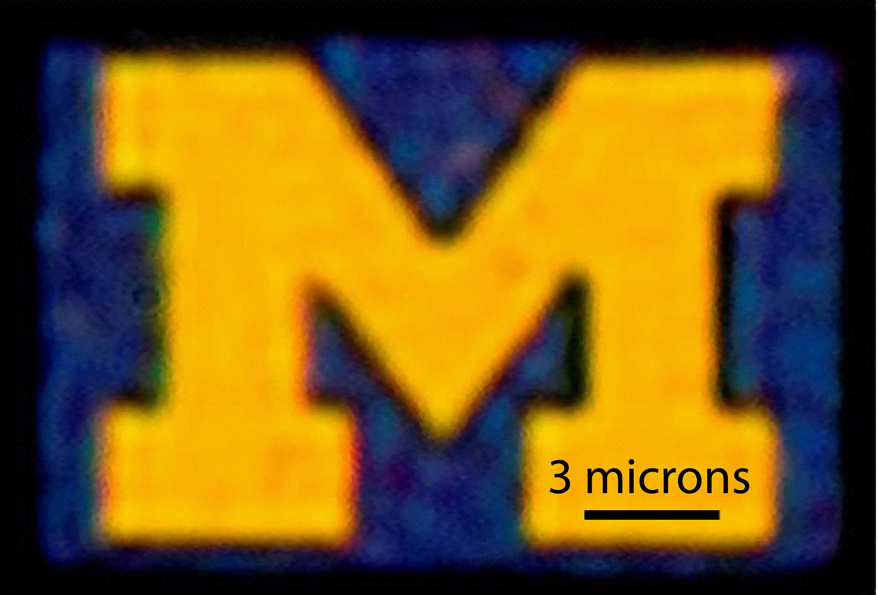 An optical microscopy image of a 12-by-9-micron U-M logo produced with this new color filter process. Credit: Jay Guo