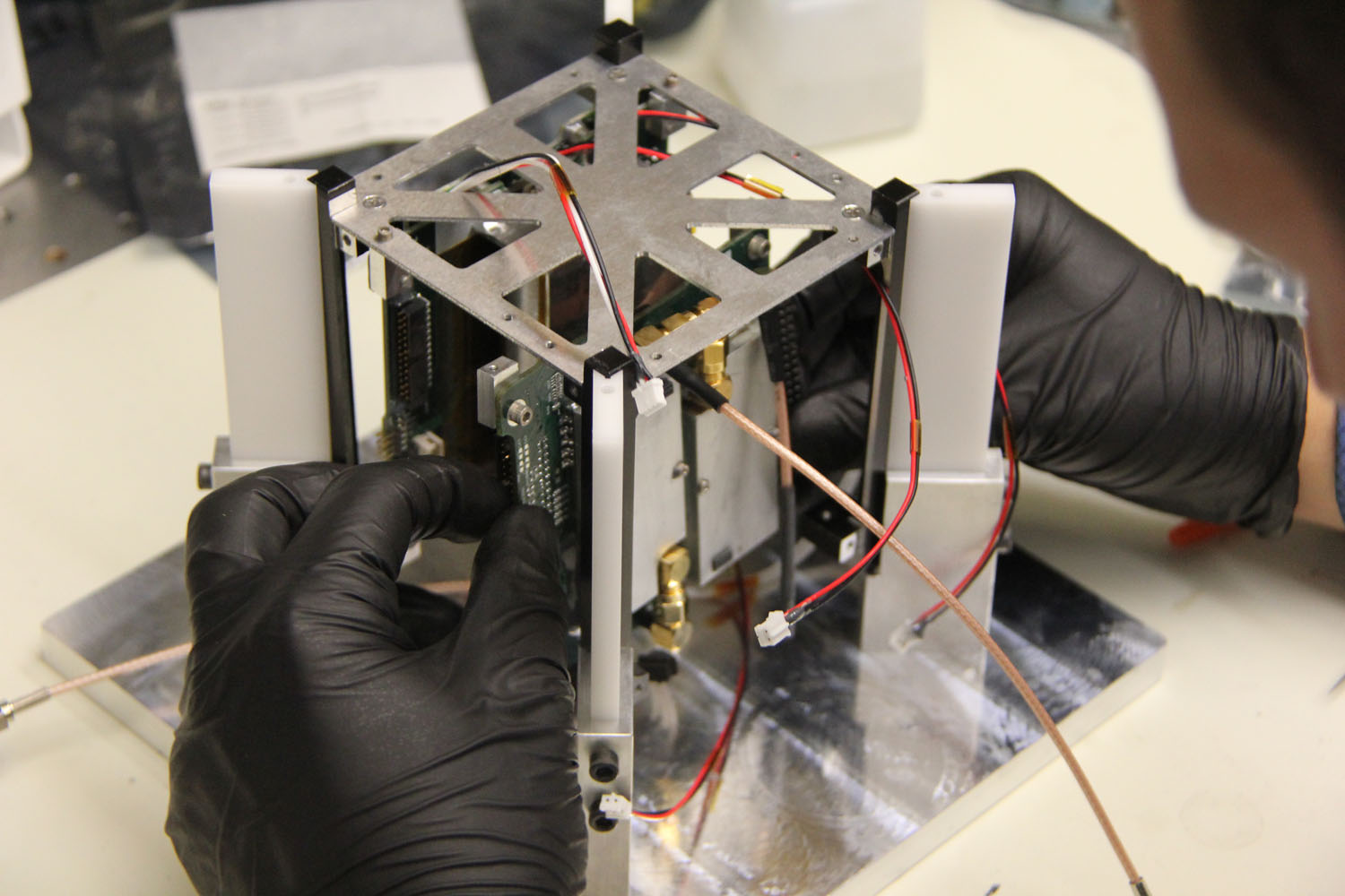 The M-Cubed CubeSat mini-satellite, built by Michigan students, will be used to test high resolution camera hardware for a future NASA Earth science mission. Credit: The Michigan Exploration Lab