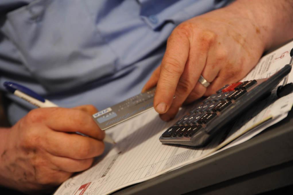 Paying bills image courtesy of FlickR.com user Wonderlane