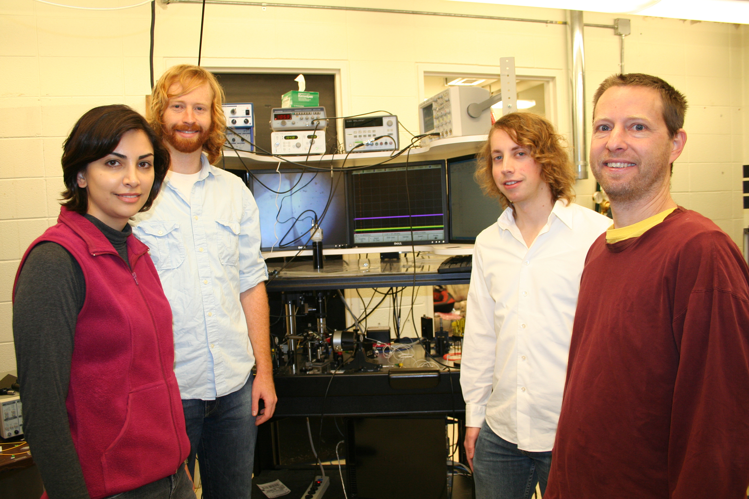 Electrical engineering and computer science researchers assistant professor Mona Jarrahi, doctoral students Jeremy Moore and Matthew Tomes and assistant professor Tal Carmon. Photo courtesy of Mona Jarrahi