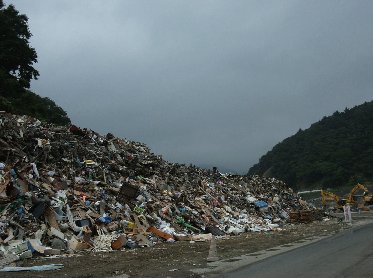 Debris from the tsunami disaster is piled high in a hard-hit coastal town in Miyagi Prefecture.