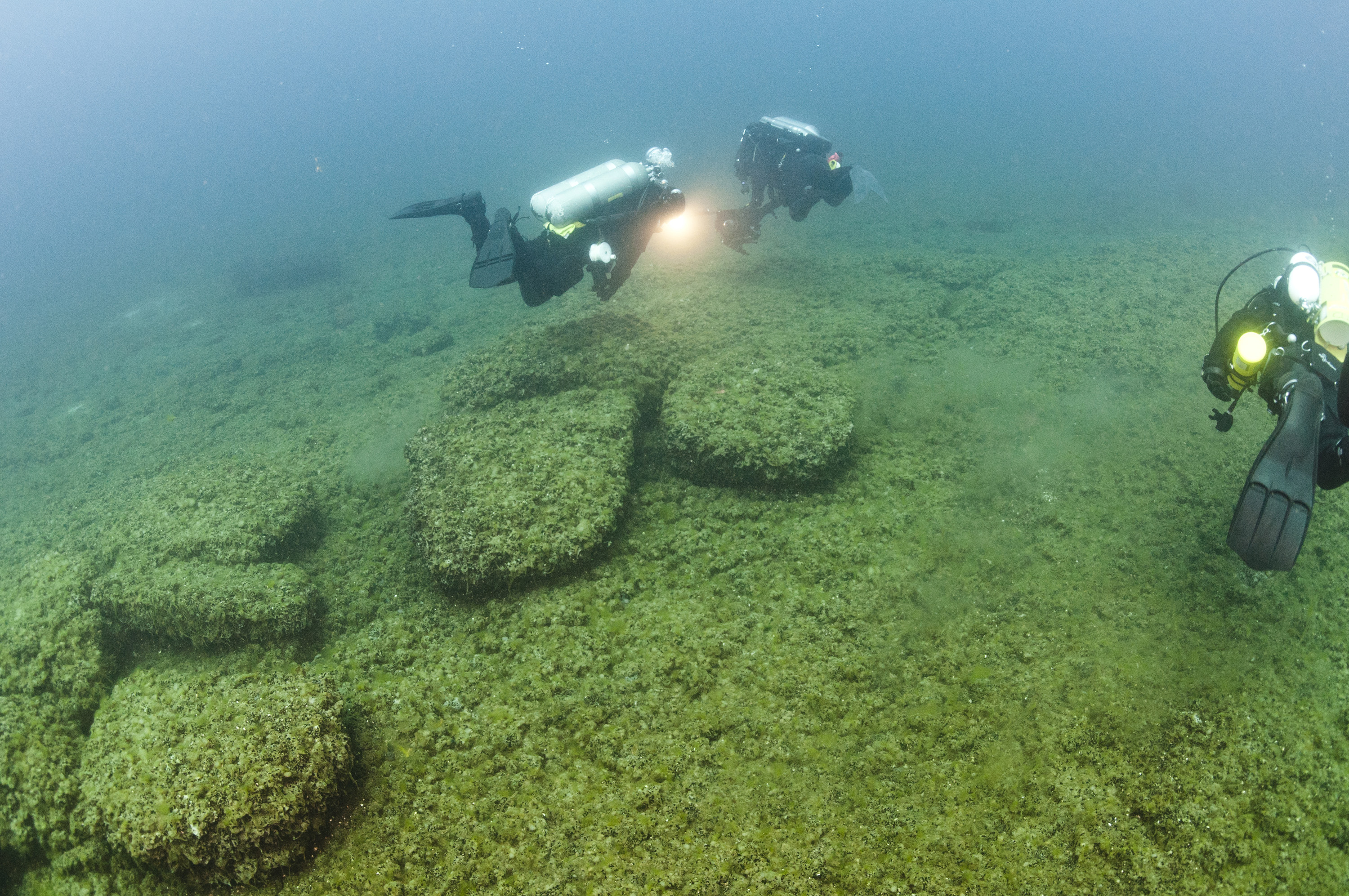 Divers examining boulders at the bottom of Lake Huron that served as caribou drive lanes for prehistoric hunters. Photo courtesy of Tane Casserly