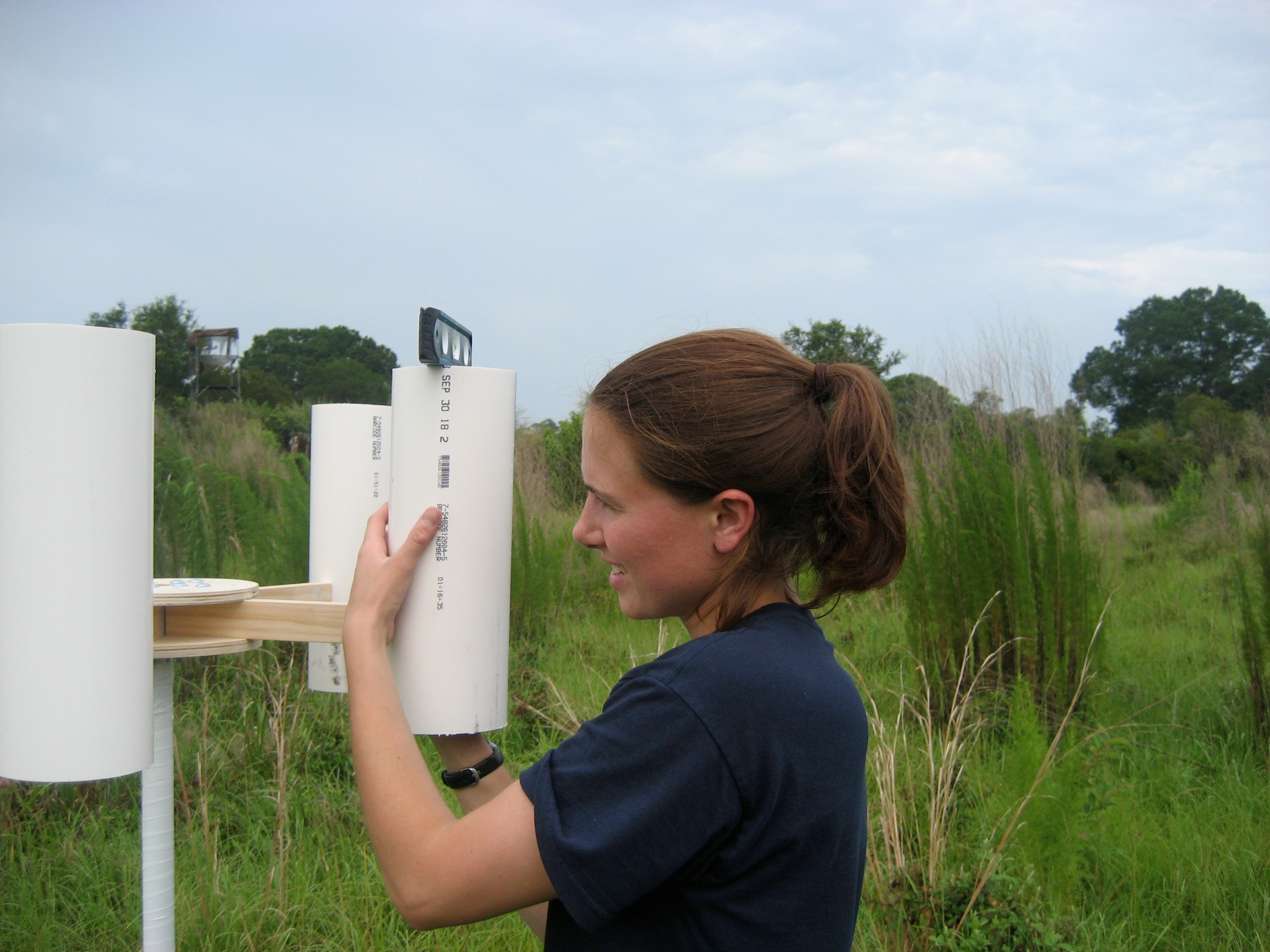 Laura Sherman setting up a sampling tripod to collect precipitation at one of the study sites near Crystal River, Florida. Photo courtesy of Emily White
