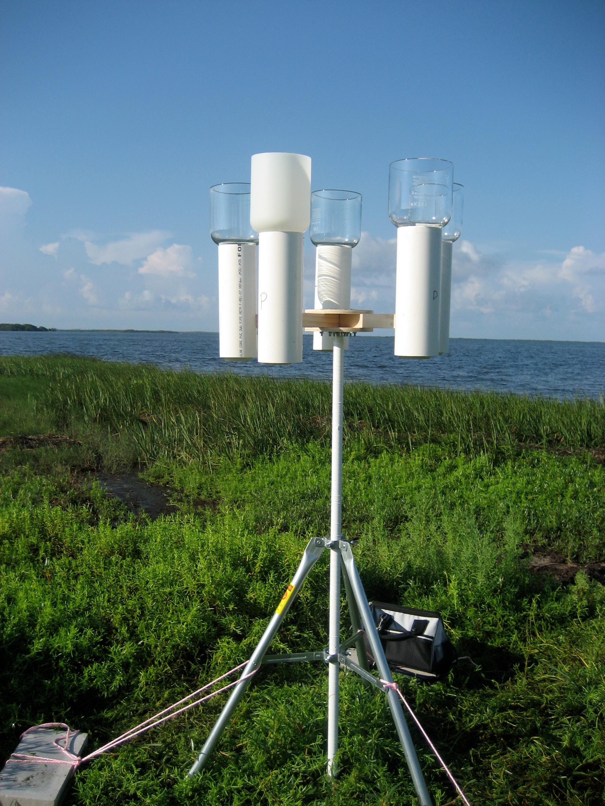 Sampling tripod with funnels to collect precipitation.  This study site was located on the Gulf of Mexico coast near Crystal River, Florida. Photo courtesy of Laura Sherman