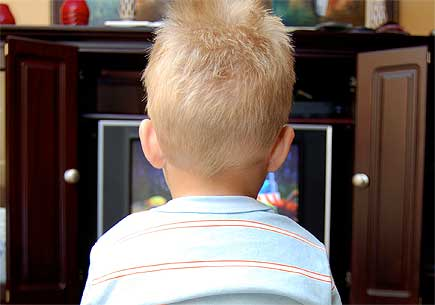 Pre-schooler watching television image courtesy of sxc.hu user Annalog85