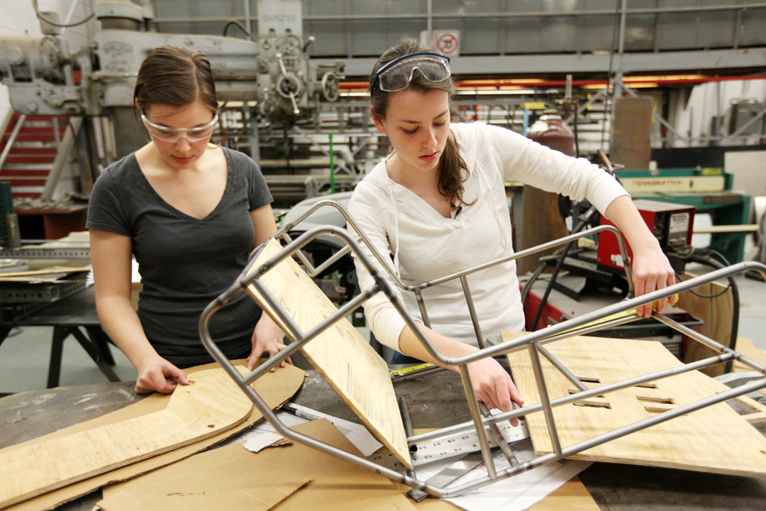Rachel Strauss (left) and Megan Bland, master's students in biomedical engineering developed an inexpensive, low-tech child car seat for use in developing nations where car seats are not mandated or even commonly used. The car seat one of the more than 100 technologies University of Michigan students have cataloged in a new wiki of medical devices for resource-limited settings. Photo by Marcin Szczepanski