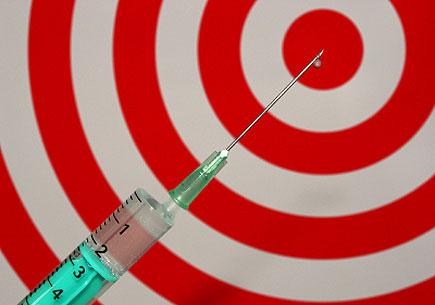 Photo of a syringe and bullseye (stock image)