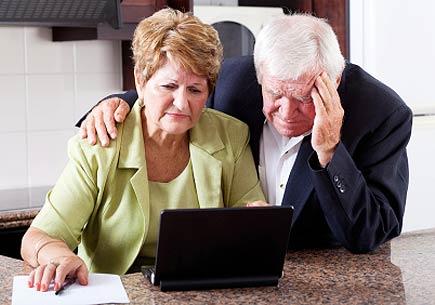 Unhappy senior couple looking worried (stock image)