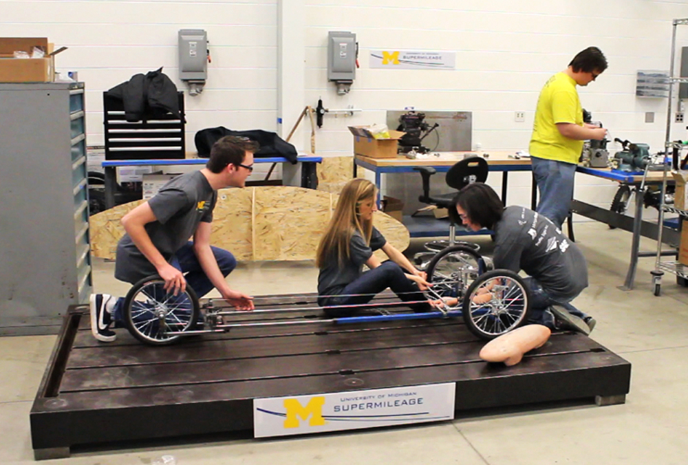 Members of the 2012 University of Michigan Supermileage Team work on their steering linkage in their workshop at the Wilson Center. Image credit: Evan Dougherty