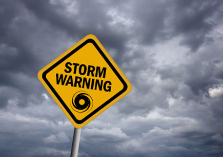 Storm warning sign over stormy sky (stock image)