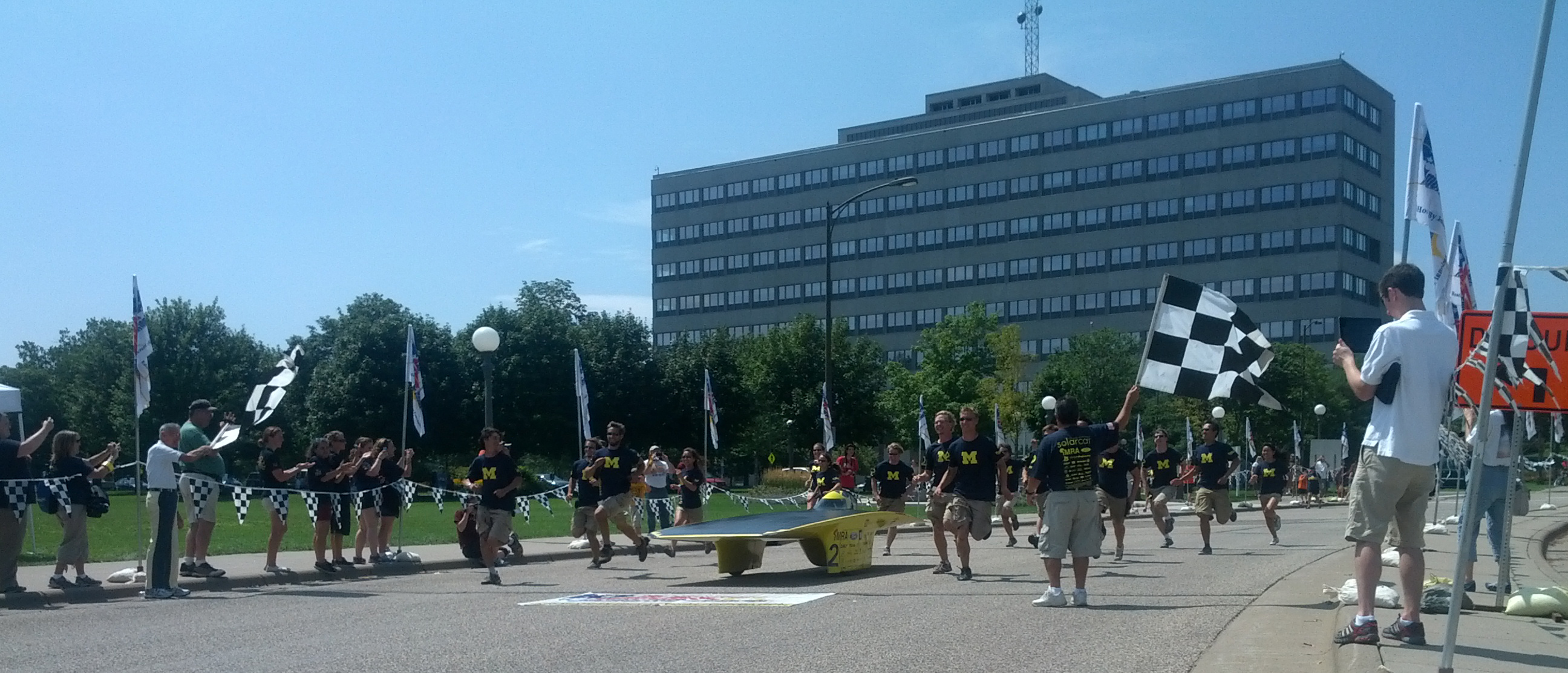 The University of Michigan Solar Car Team, with its car Quantum, crosses the finish line at 2:30pm on July 21, 2012 at the American Solar Car Challenge in St Paul, Minn.. The team won its fourth consecutive national championship with this event (and 7th overall), and broke the national record, winning by 10 hours and 18 minutes over its nearest competitor. Image credit: Ethan Lardner, U-M Solar Car Team