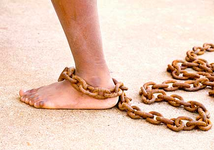 Photo of a small dirty lef with a chain around the ankle (stock image)