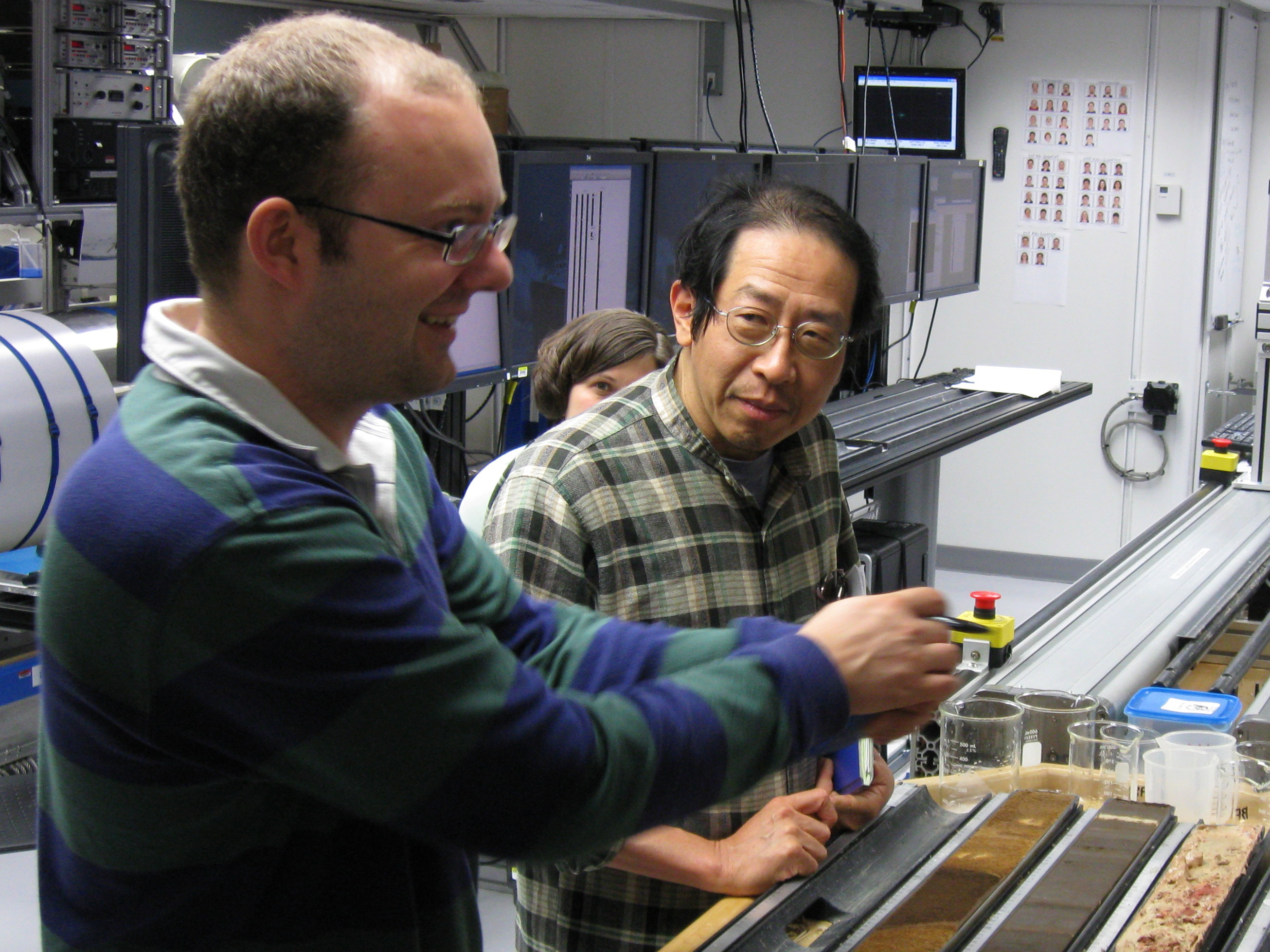Expedition 320 Co-chief Scientists Heiko Pälike (University of Bremen, Germany) and Hiroshi Nishi (Hokkaido University, Japan) in the Core Lab. Image credit: Integrated Ocean Drilling Program/United Stated Implementing Organization (IODP/USIO)