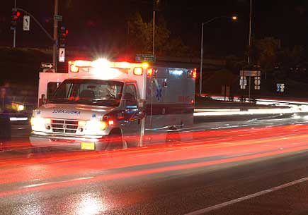 A ambulance at the scene of a motor vehicle accident during the early winter evening. (stock image)