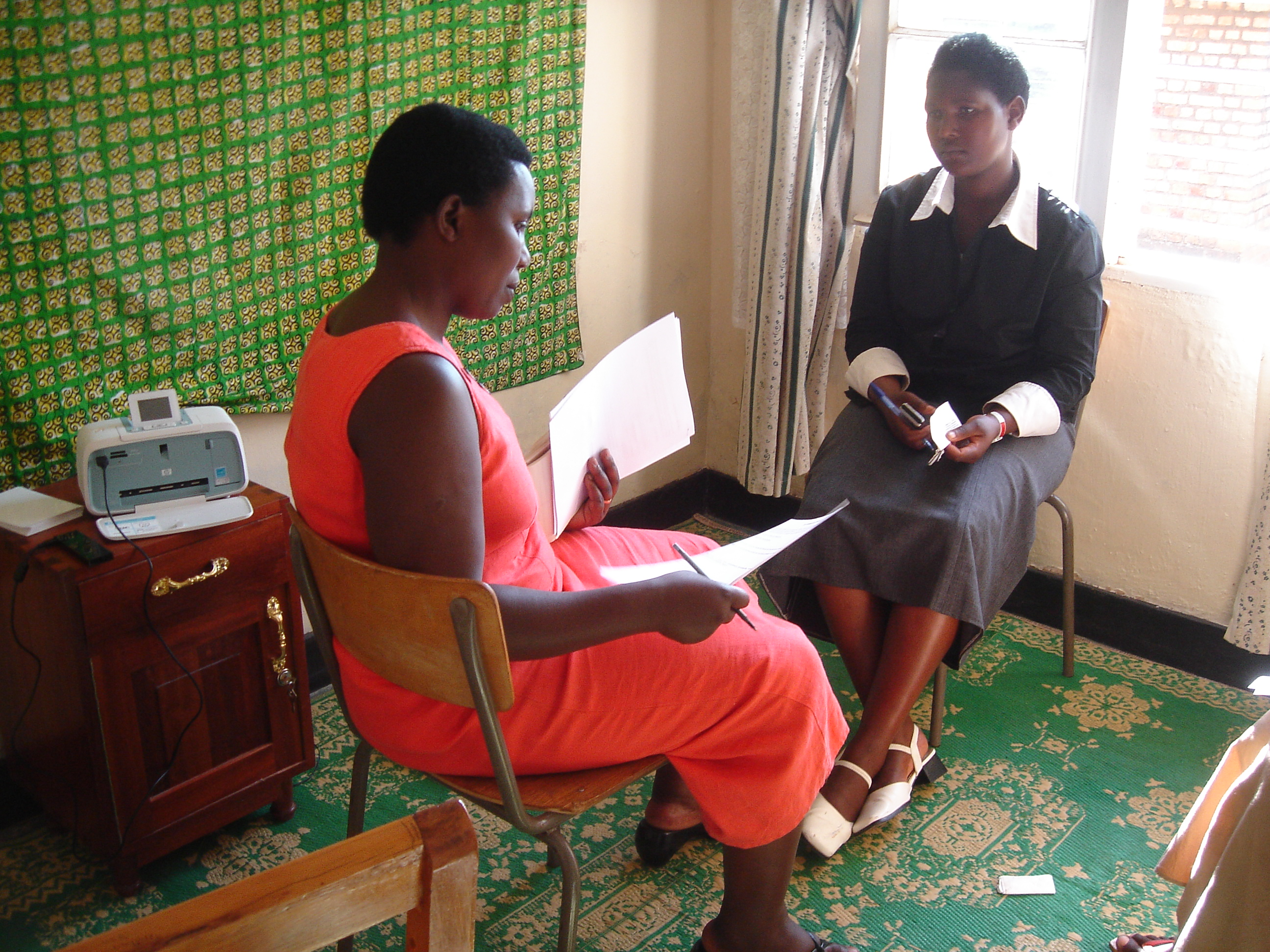 Mukakayange Veronique trains Stories for Hope facilitator Kakuze Josiane. Stories for Hope Rwanda is a storytelling project that brings young people and elders together to talk about the past as a way to break the silence between generations that has fallen since the genocide. Photo Courtesy of Patricia Pasick