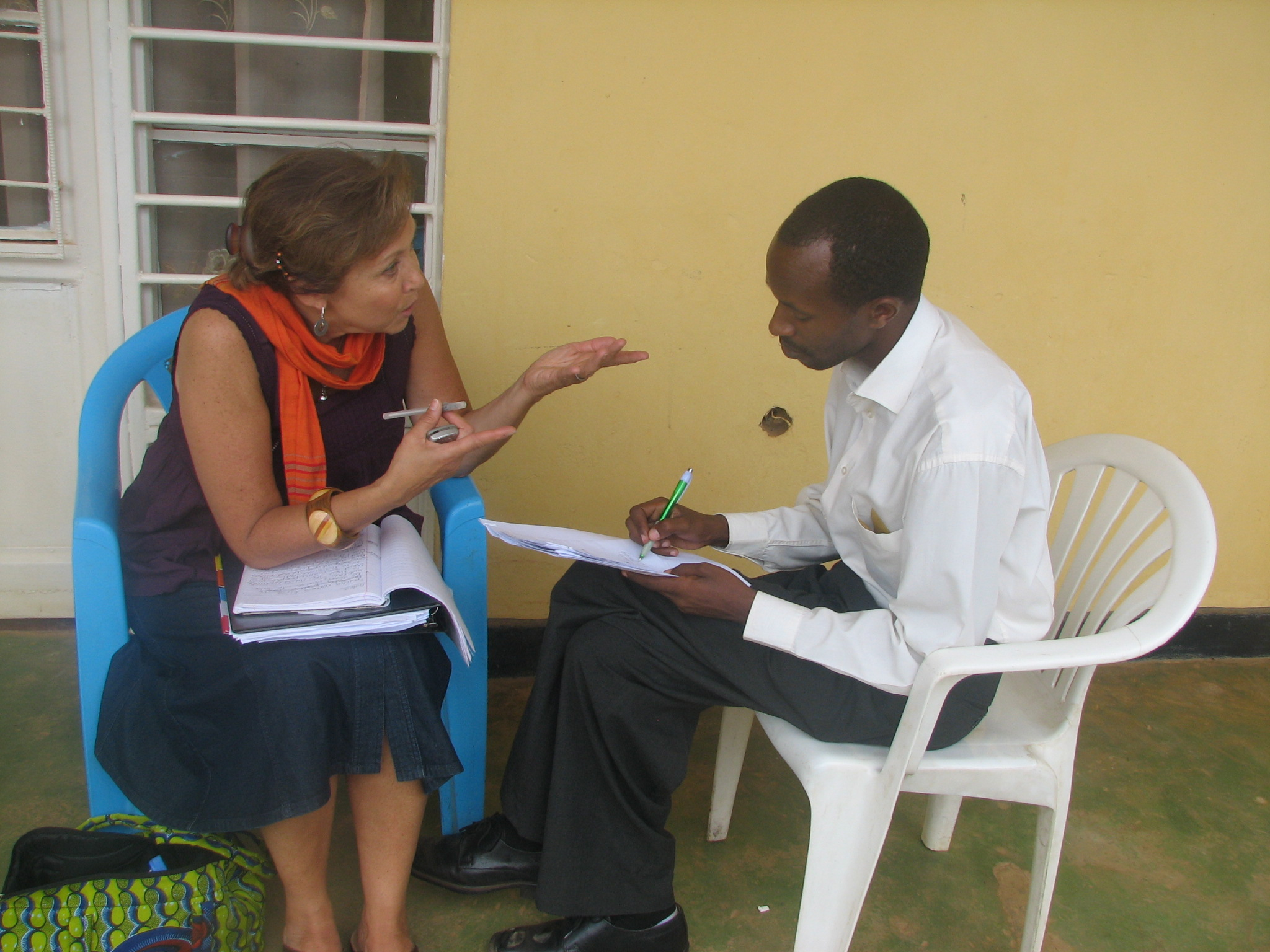Patricia Pasick, founder of Stories for Hope talks about the project with Kanamugire Theophile, director of a local NGO in Nyamata, Rwanda. Photo courtesy of Patricia Pasick