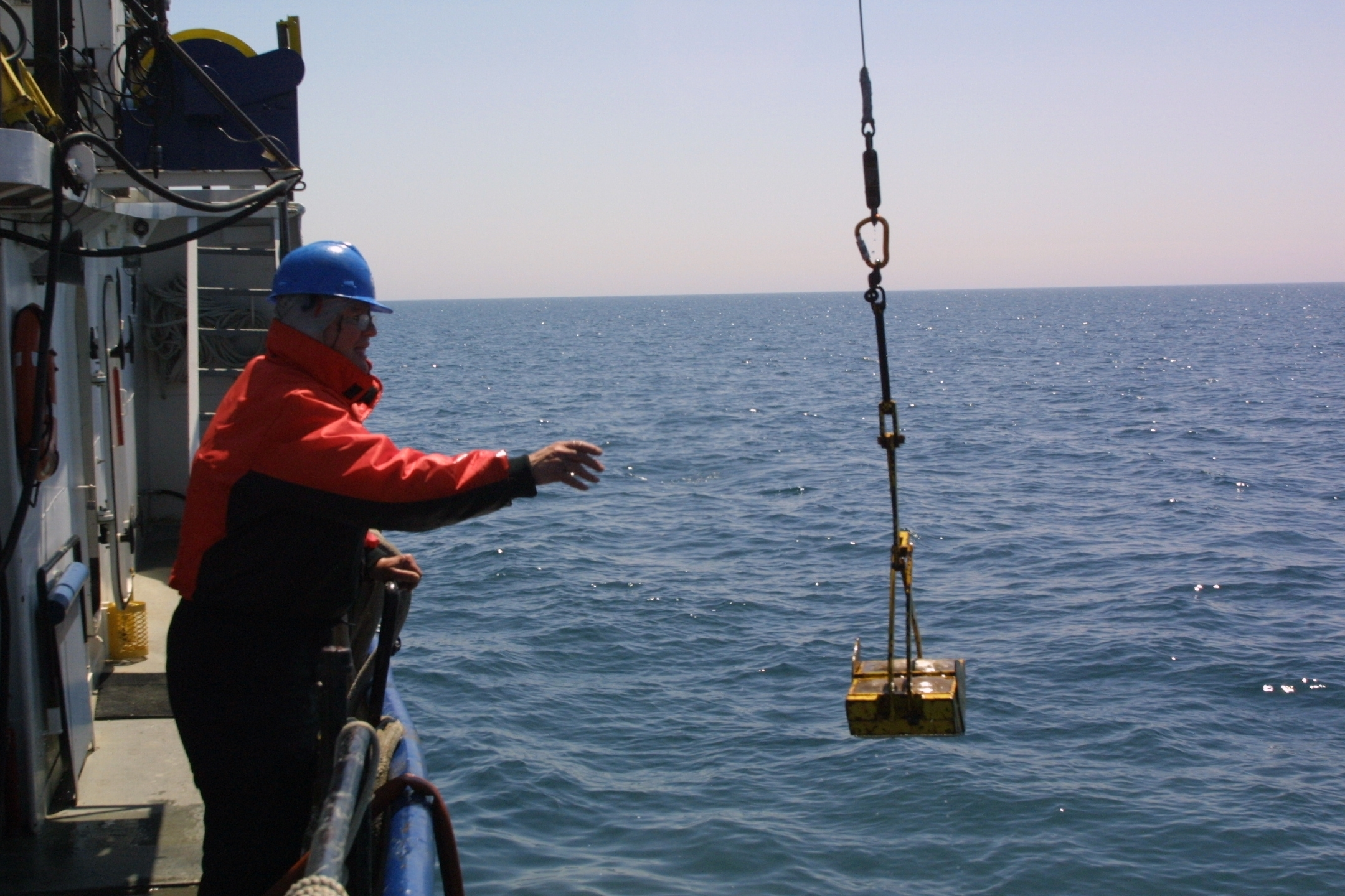 University of Michigan researcher David Jude collecting samples on Lake Michigan in 2009, during a study of quagga mussels. Photo by Jim Erickson