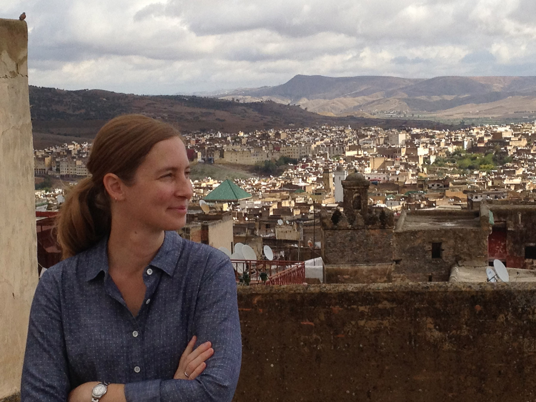 Fulbright grantee Andrea Urbiel Goldner, who teaches in the School of Natural Resources and Environment, on the roof of her house in Fes, Morocco, where she is studying landscape architecture.
