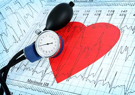 A blood pressure monitor on a printout of a heart and heartbeat graph. (stock image)