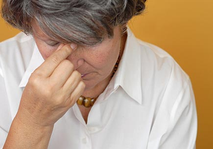 Sad and depressed older woman in pain (stock image)
