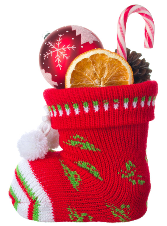 Christmas stocking stuffed with ball, orange and a candy (stock image)