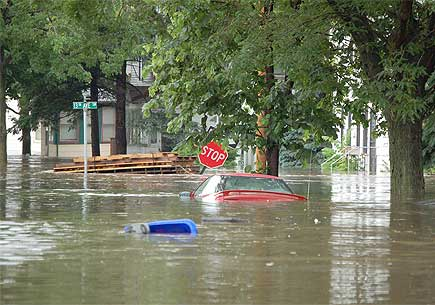 A flooded urban street. Image credit: Don Becker, USGS