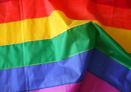 Detail of the rainbow (gay) flag, with folds and creases. (stock image)