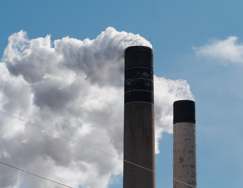 Smokestacks, in Champaign, Illinois. Image credit: wikimedia commons user Dori