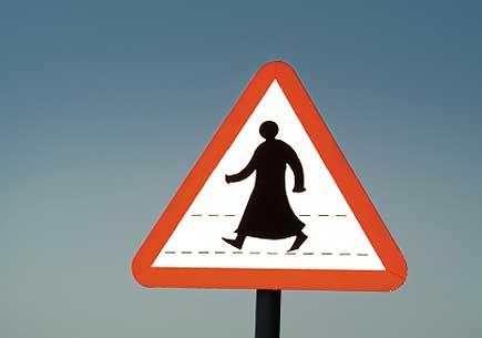Pedestrian sign in Doha, Qatar. (stock image)