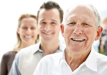 Closeup portrait of an old man smiling with his son and daughter in background. (stock image)