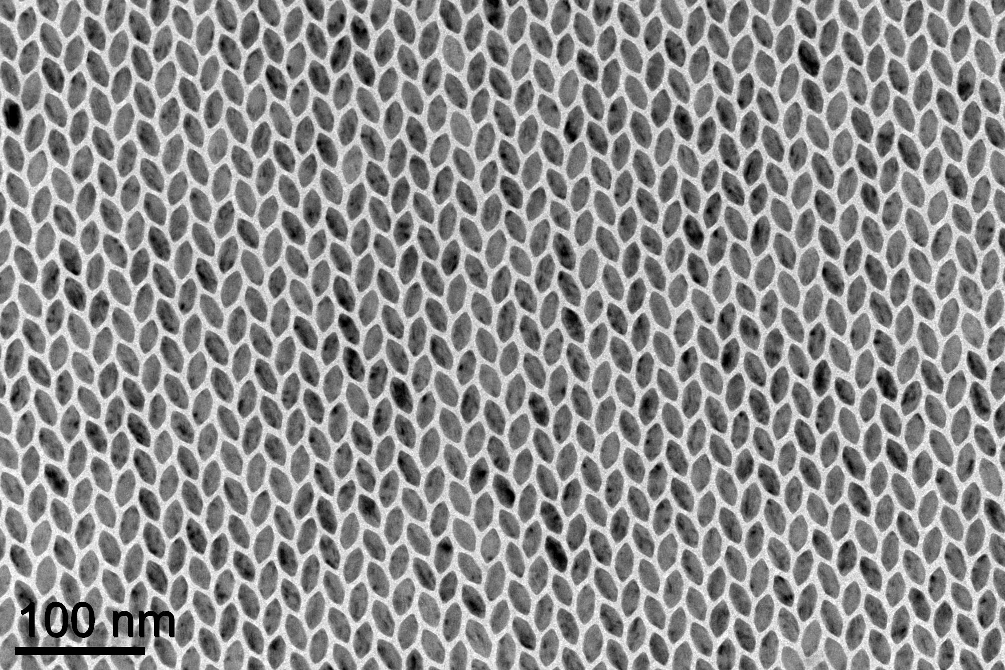 Hexagon-shaped nanoplates arranged themselves into different crystal patterns, depending on the length of the sides of the hexagons. Long hexagons fit together in a grid like a stretched honeycomb, but researchers were surprised that hexagons whose sides were all the same lengths ended up in a herringbone pattern. University of Michigan engineering researchers helped figure out why, and the work could lead to a new tool to control how nanoparticles arrange themselves. Credit: Xingchen Ye, University of Pennsylvania
