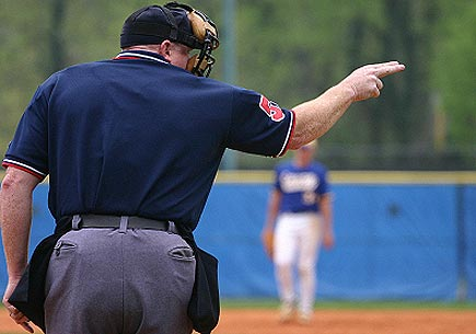 An umpire calling strike two. (stock image)