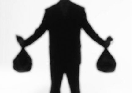 Silhouette of a man holding money bags. (stock image)