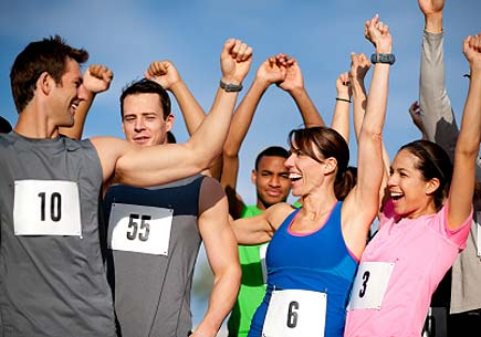 A group of runners celebrates. (stock image)