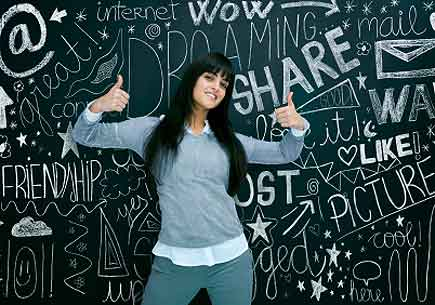 Young girl in front of a chalkboard covered with social network-related images and text. (stock image)
