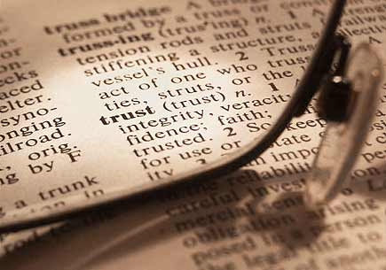 Photo of a dictionary definition of trust. (stock image)