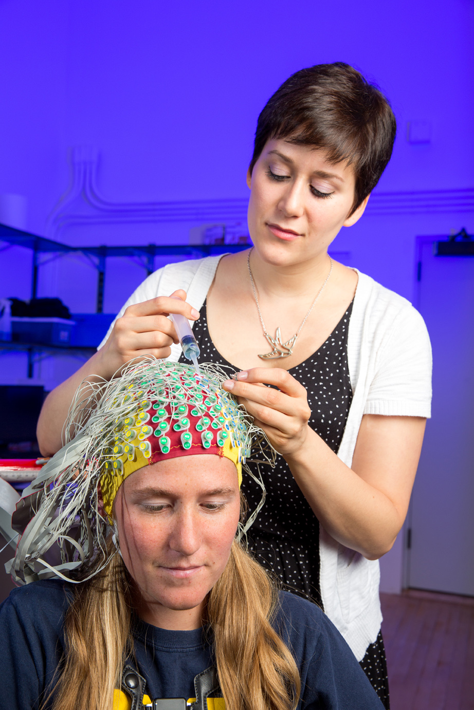 Subject being fitted with electrodes, which will help researchers look at his brain activity during a fall. Image credit: Ferris Lab