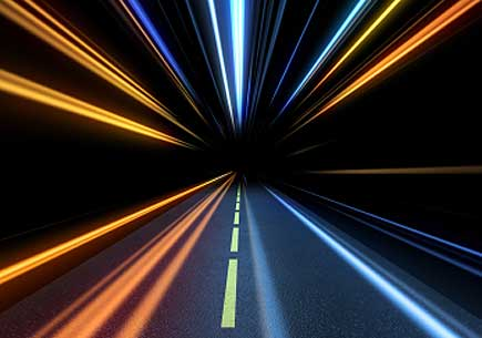 Abstract image depicting high-speed travel on a highway. (stock image)