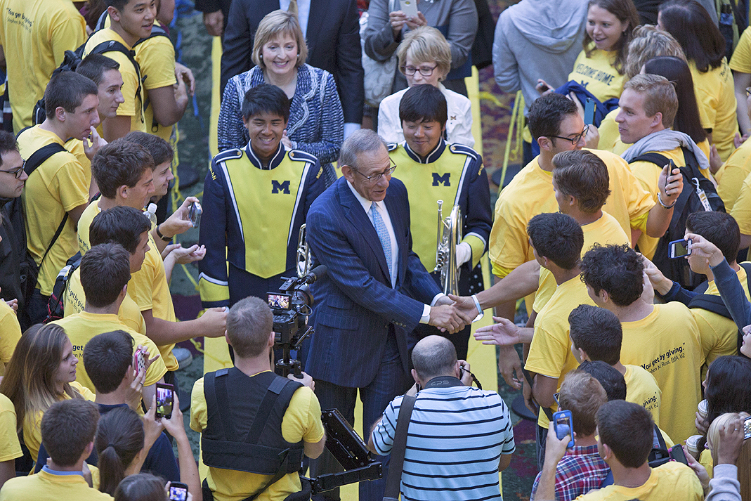 Ross shakes hands with students gathered this morning to celebrate the gift. Image credit: Michigan Photography