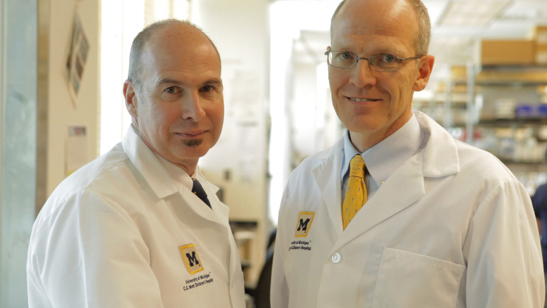 Scott Hollister, Ph.D., is at left, Glenn Green, M.D., is at right.