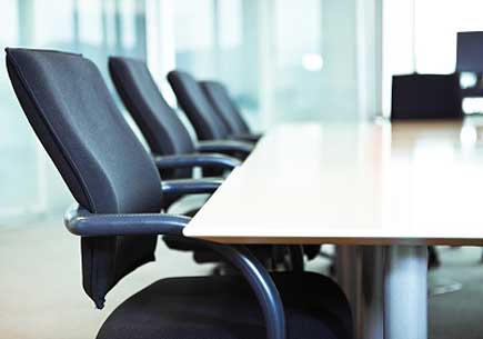 Empty chairs at the boardroom table. (stock image)