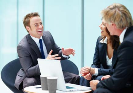 An executive tells an entertaining tale to his colleagues. (stock image)