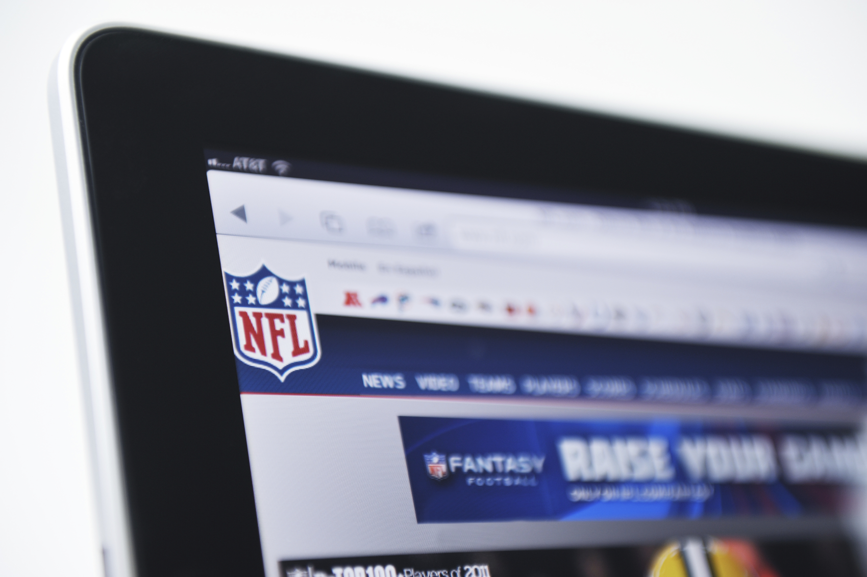 Holding an iPad Displaying the NFL Logo and Fantasy Football website. (stock image)