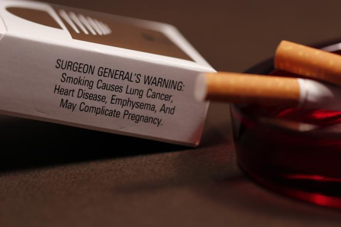 An opened pack of cigarettes with its side-panel health warning to would-be smokers stating some of the ill effects attributed to smoking. Image credit: Debora Cartagena, Centers for Disease Control and Prevention