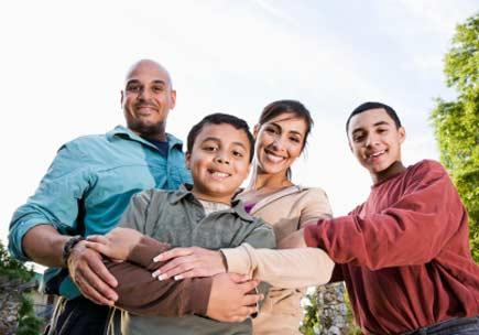 Portrait of Hispanic family outdoors. (stock image)