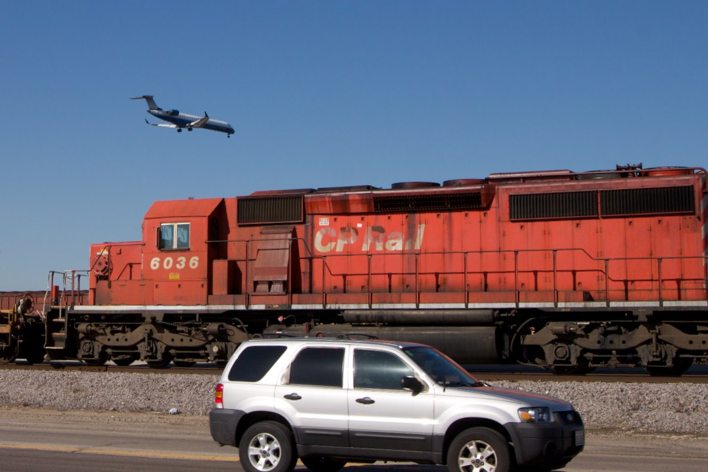 A plane, a train, and an automobile. Image credit: flickr.com user H. Michael Miley