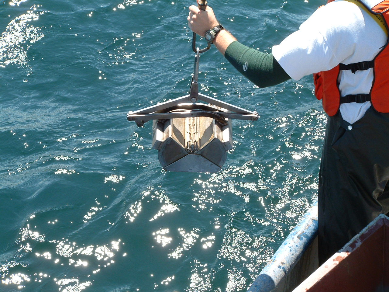 A sampling device called a Ponar Grab is lowered in Lake Erie's Central Basin to collect bottom-dwelling invertebrates. The work was part of a study examining the impacts of low-oxygen hypoxic zones in the lake. Image credit: James Roberts