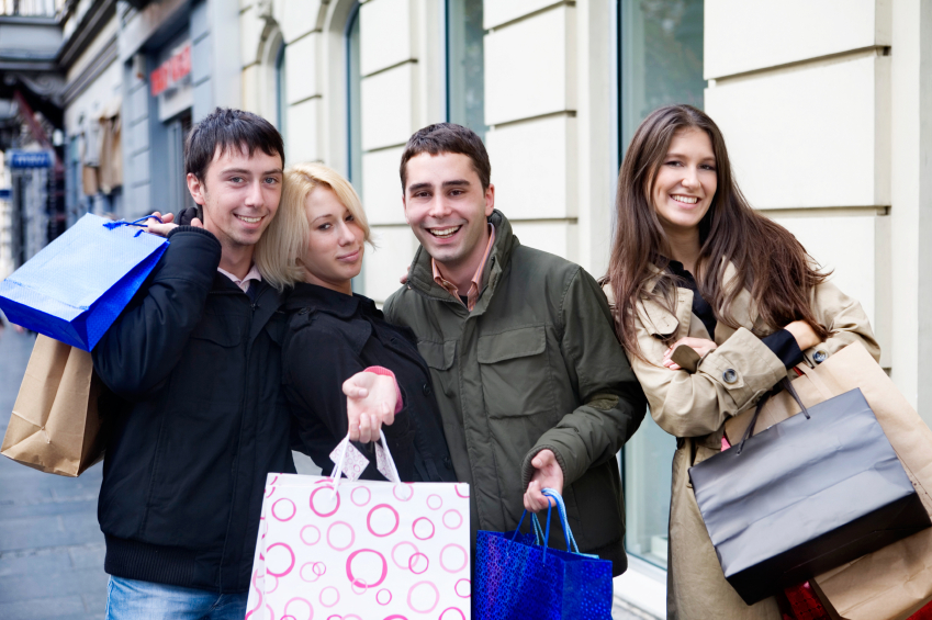 A group of teens enjoying a day of shopping. (stock image)