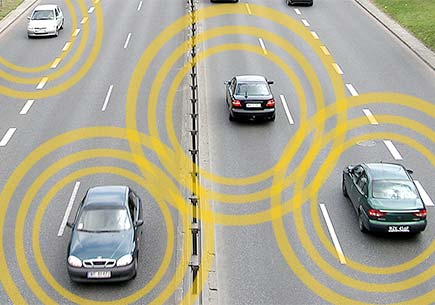 Several cars on a roadway with each emitting communication signals.