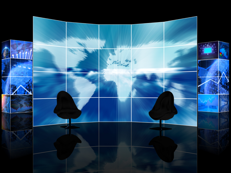Digital news TV studio with two empty chairs in front of a large digital display featuring a map. (stock image)